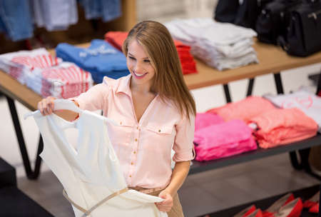 clothing store: Young girl in the store Stock Photo
