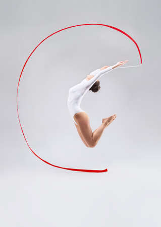 Jumping girl with tape in the studio
