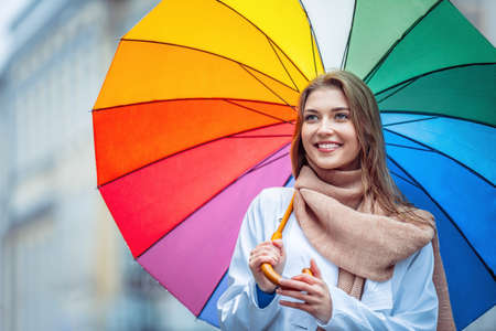 young woman smiling: Young girl with an umbrella Stock Photo
