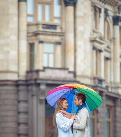 autumn young: Young couple with an umbrella