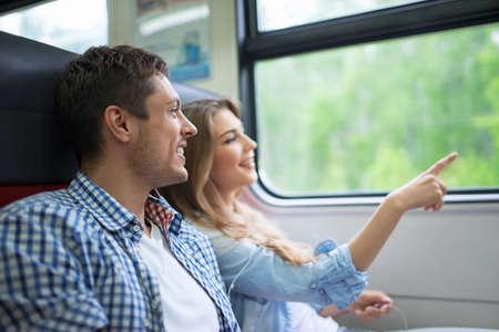 Young couple in the train Foto de archivo