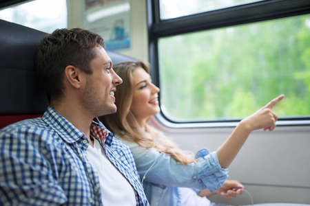 Young couple in the train Stock Photo
