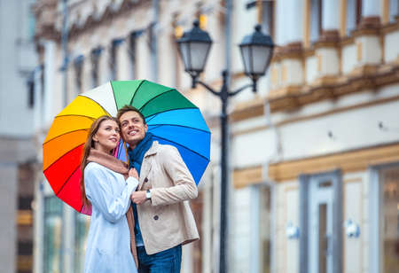 love in rain: Young couple with an umbrella
