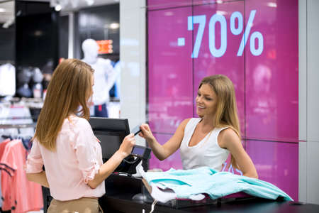 female clothing: Young girl is at the checkout in the store