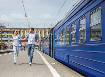 Running couple at the train station