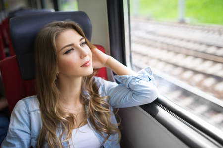 student travel: Young girl of the train