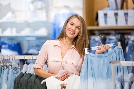 fashion clothing: Young girl is in a shop