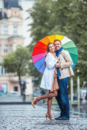 love in rain: Couple with an umbrella on the street