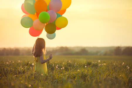 at leisure: Little girl with balloons outdoors