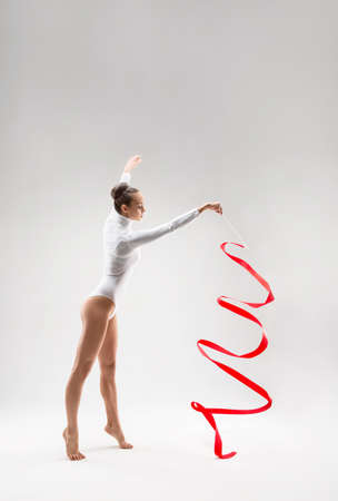young gymnast: Young gymnast with tape in the studio Stock Photo