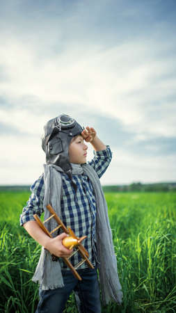 child boy: Little boy with airplane in the field