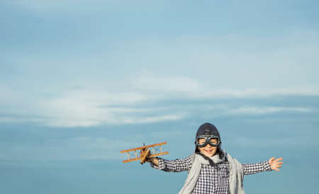 Happy boy with wooden airplane