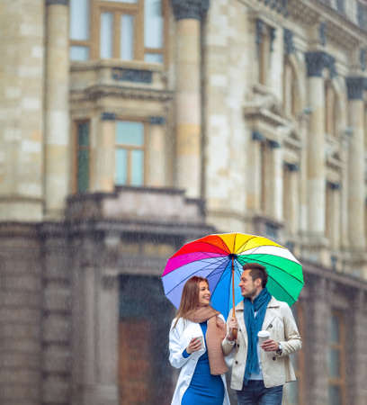 romantic couple: Young couple with an umbrella on the street