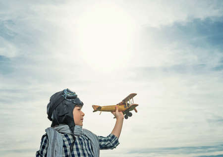 air transport: Little boy with wooden airplane outdoors