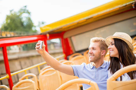 self discovery: Young couple making self at the tour bus Stock Photo