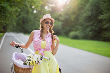 female beauty: Young girl on a bicycle outdoors Stock Photo