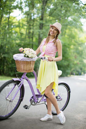 carefree: Smiling girl on a bicycle in the park Stock Photo