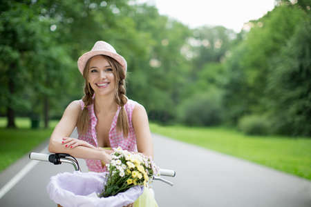 summer nature: Young girl on a bicycle outdoors Stock Photo