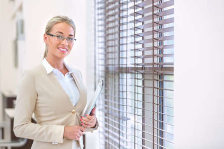 indoors: Young business woman indoors