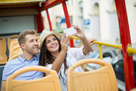 self discovery: Young couple making selfie outdoors