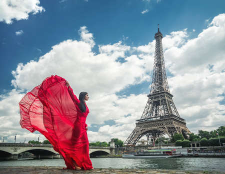 glamour nude: Beautiful girl in a red dress in Paris