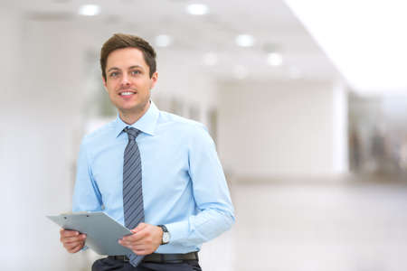 indoors: Young business man indoors Stock Photo