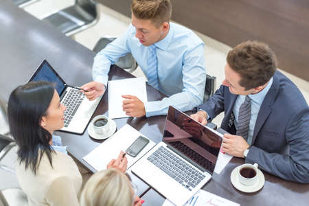 business people: Young business people  in office