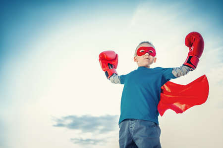 children sport: Little boy with boxing gloves outdoors