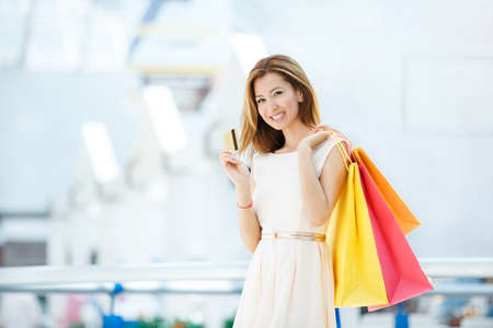 shopping card: Attractive girl with shopping bag in the store Stock Photo