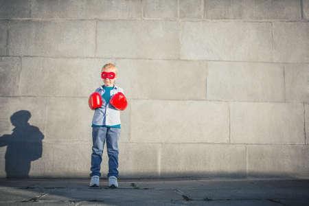 dreamlike: Little boy with boxing gloves