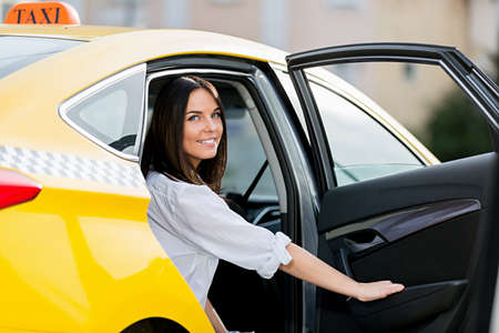 charming woman: Beautiful girl in a taxi Stock Photo
