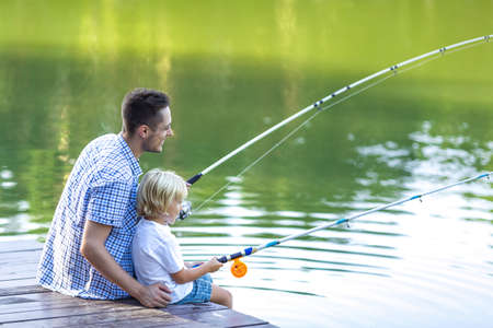 the river: Dad and son fishing outdoors