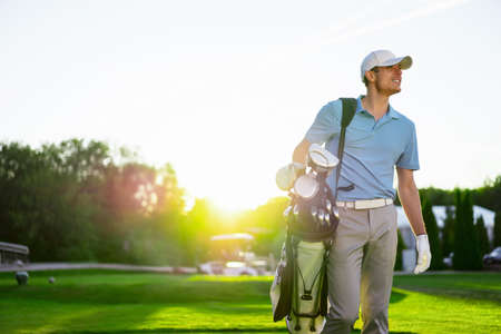 golf bag: Young man outdoors Stock Photo