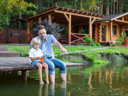 house family: Father and son fishing on the lake