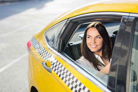 a yellow taxi: Beautiful girl in a yellow taxi