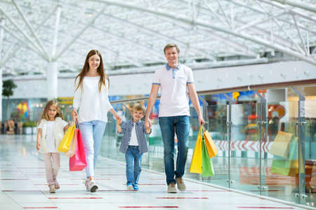 family indoors: Families with a children in a store