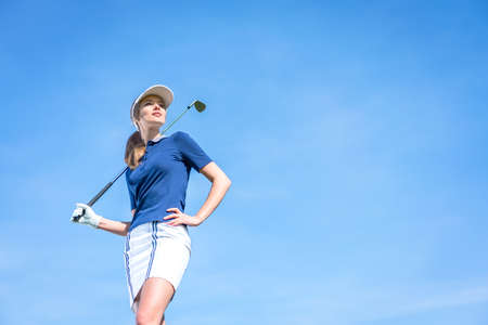 Young girl with a golf club outdoors