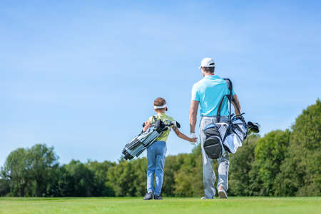 Father and son on golf course 스톡 콘텐츠