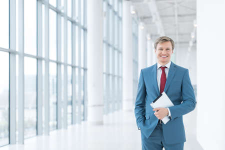 mature business man: Young businessman with tablet in office