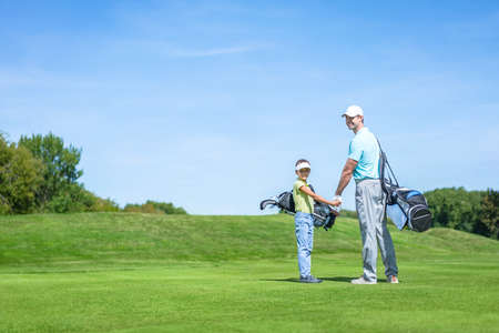 dad son: Dad and son on golf lawn
