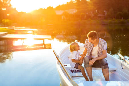 Dad and son on a boat outdoors