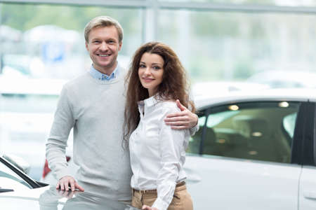 Couple buying a car in autocenter