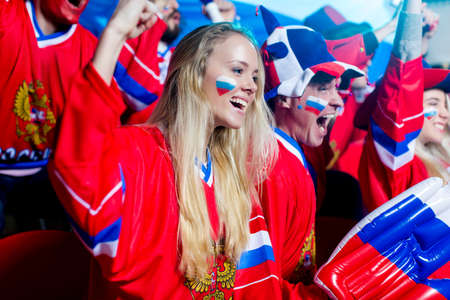 spectators: Young spectators in uniform in stadium