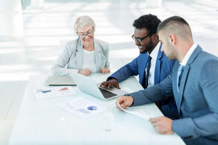 Business people at table in office