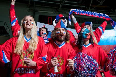 sports fans: Happy sports fans in stadium