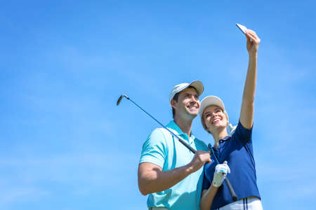 golfer: Smiling golfers making selfie outdoors Stock Photo