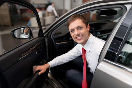 seller: Young attractive seller in car
