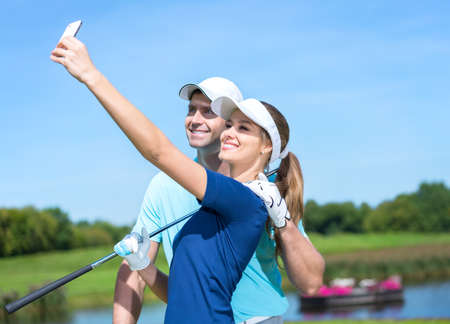 golfer: Attractive couple making selfie