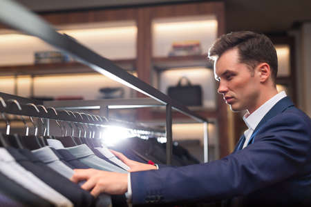 indoors: Young businessman in suit indoors
