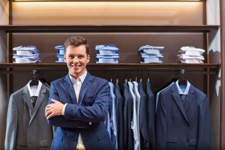 indoors: Smiling businessman in suit indoors